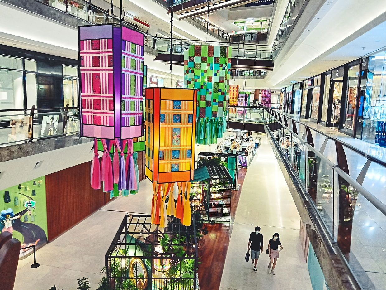 The giant lanterns at The Gardens Mall sport a batik sarong-themed patchwork design.