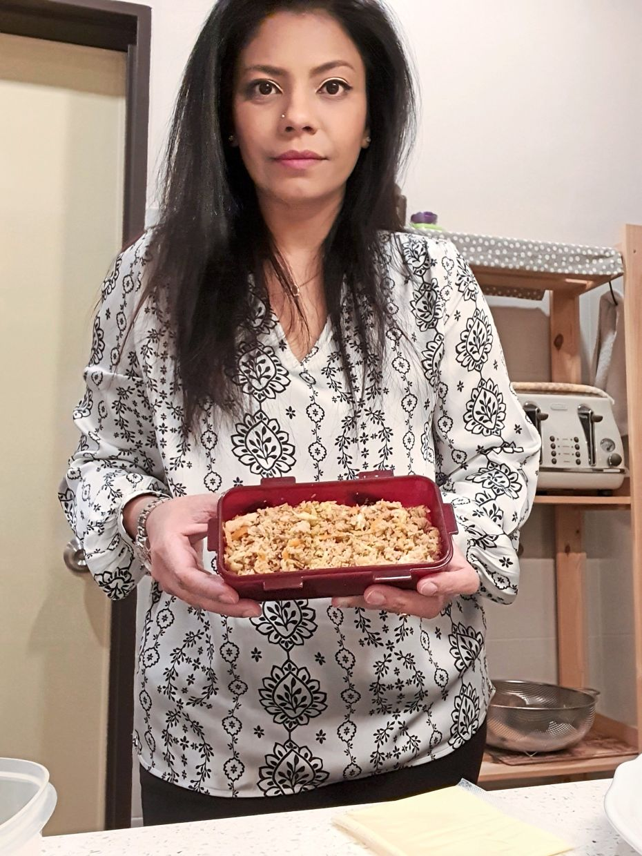 Lynn wakes up at 4am every day to prepare breakfast and lunch for her family, while her husband takes care of dinner. — LYNN ANNE JOHNSON