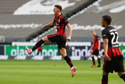 Soccer-Late Hrustic goal keeps Eintracht in Champions League contention