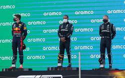 Motor racing-Hamilton defends Bottas after slow response to team order