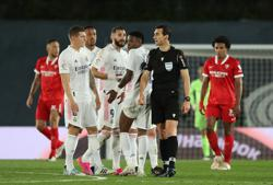 Soccer-Title-chasing Real snatch draw with Sevilla after VAR drama