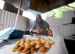 Kuih baulu, a sweet and traditional treat during Hari Raya