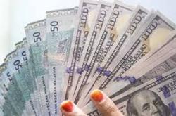 Ringgit ends firmer against US dollar at 4.1050