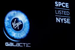 Virgin Galactic 'evaluating' timeline for next flight test, shares drop