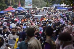 1.2 million Jakartans go hometowns amid exodus ban despite Covid-19 cases rising to 1,723,596
