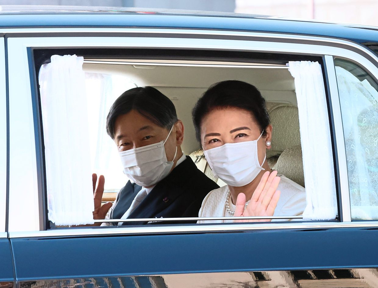 Japanese Emperor Naruhito and Empress Masako arriving at the Imperial Palace to attend the ceremony of