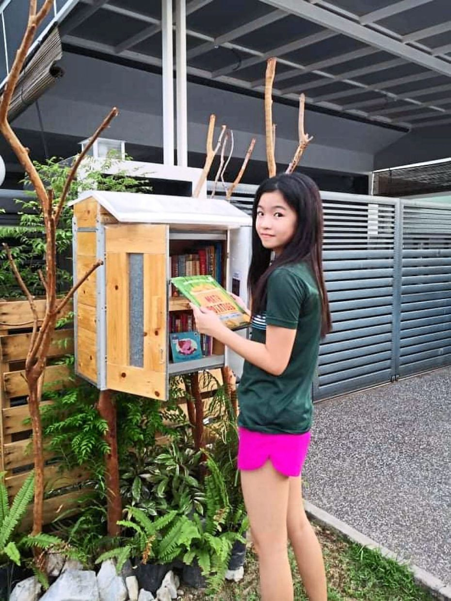 Teenager Angel Yip is one of the happy patrons of the street library.