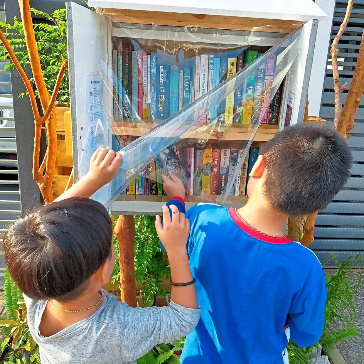 Children are always excited to source for new books at the street library.