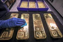 Gold holds near three-month high