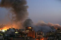 Gaza residential tower collapses in Israeli airstrike, witnesses say