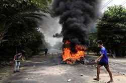Myanmar arrests 39 over blasts, seeking training with rebels - media