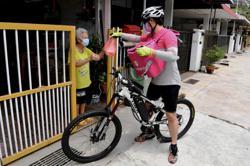 Penang physiologist makes ends meet as Foodpanda cyclist