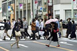 Japan passes digital law as virus underscores tech struggles