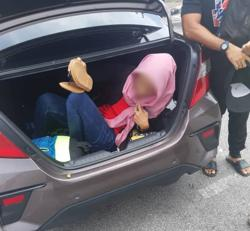 Thwarted – e-hailing driver's bid to smuggle illegal who misses her husband past a roadblock
