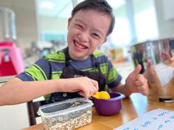Malaysian student with Down Syndrome uses his baking skills for a good cause