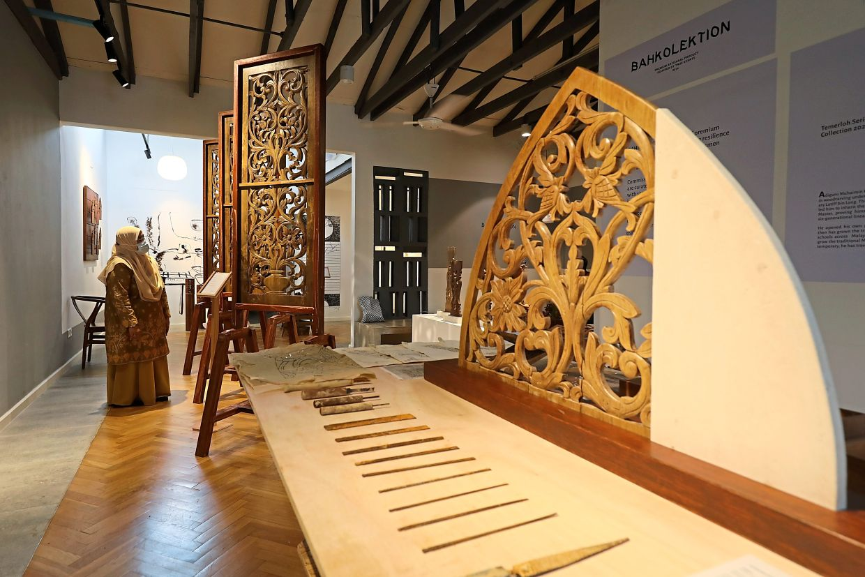 The recent Temerloh Series 2021 at Rumah Lukis featured restored woodworks by Muhaimin which were damaged in a flood in 2014. Photo: The Star/Samuel Ong