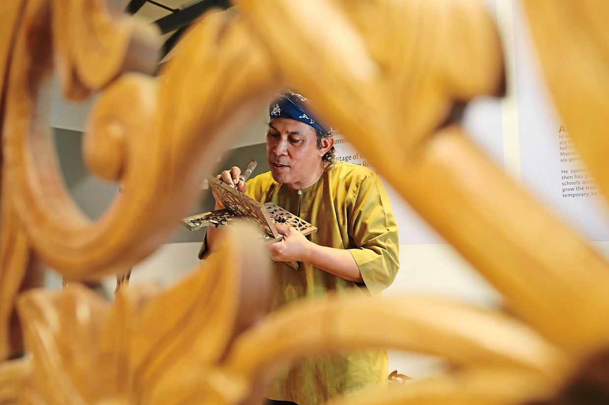 Muhaimin hopes more young people will start venturing into wood carving to keep the traditional art alive. Photo: The Star/Samuel Ong
