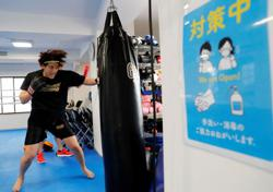 In Japan, boxing nurse's Olympic dream crushed by COVID-19