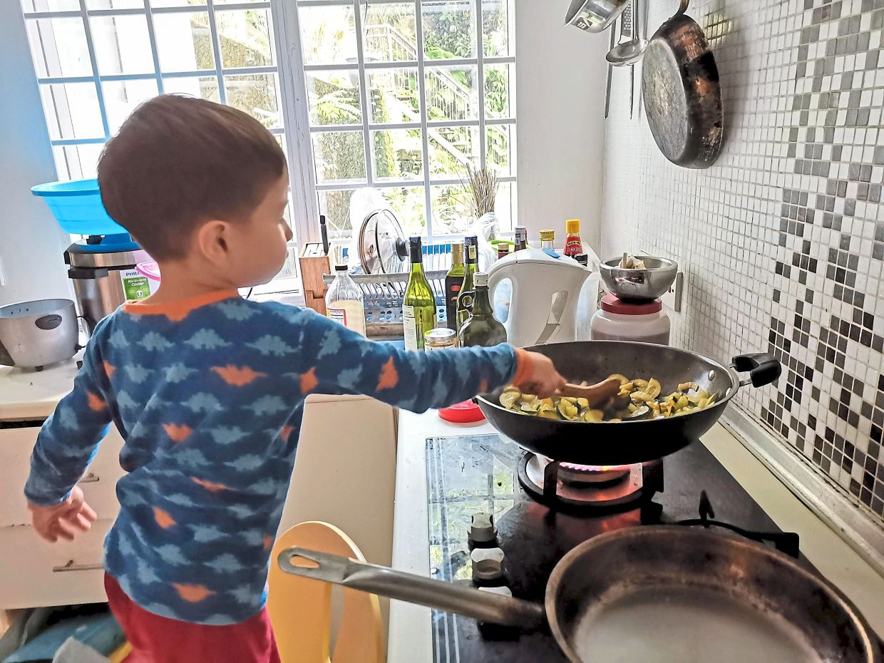 The children learning to cook at home during the MCO. Photo: Jessica Ong