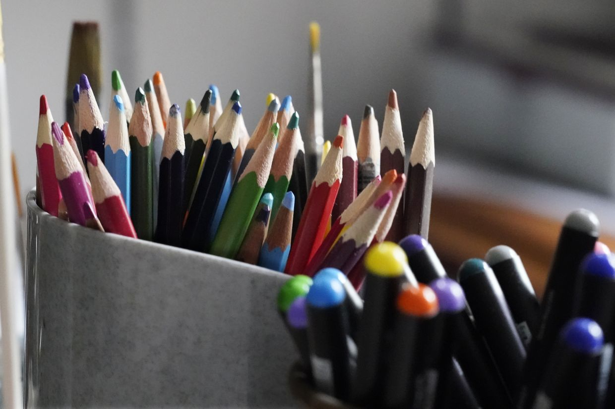 Coloured pencils, sharpened and at the ready, rest in a container on the desk of artist Seaman in his room at an assisted living facility. Photo: AP