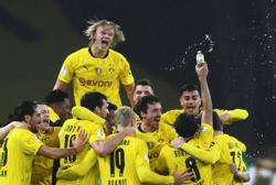 Soccer-Sancho, Haaland doubles fire Dortmund to German Cup glory