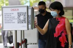 Singapore stocks tumble as strict virus curbs return