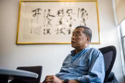 Hong Kong government freezes assets of media tycoon Jimmy Lai