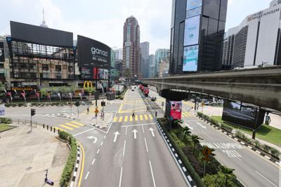 General view of the near empty Jalan Bukit Bintang during first day of Hari Raya in Kuala Lumpur, Malaysia, May 13, 2021. The government implemented a nationwide movement control order (MCO) beginning May 12 until June 7 due to the rapidly rising Covid-19 case numbers. GLENN GUAN/The Star/The Star