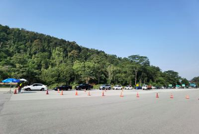 Police checking validity of travel documents at roadblocks set before the Gombak toll on the first day of Hari Raya. MCO 3.0 disallowed interstate travel without proper documents. YAP CHEE HONG/The Star