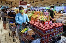 Taiwan raises alert level after coronavirus cases surge