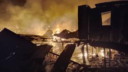 Firemen, villagers struggling to put out blaze raging through Kampung Meruntum, Sabah