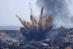 Israeli airstrike in Gaza destroys building with AP, Al Jazeera