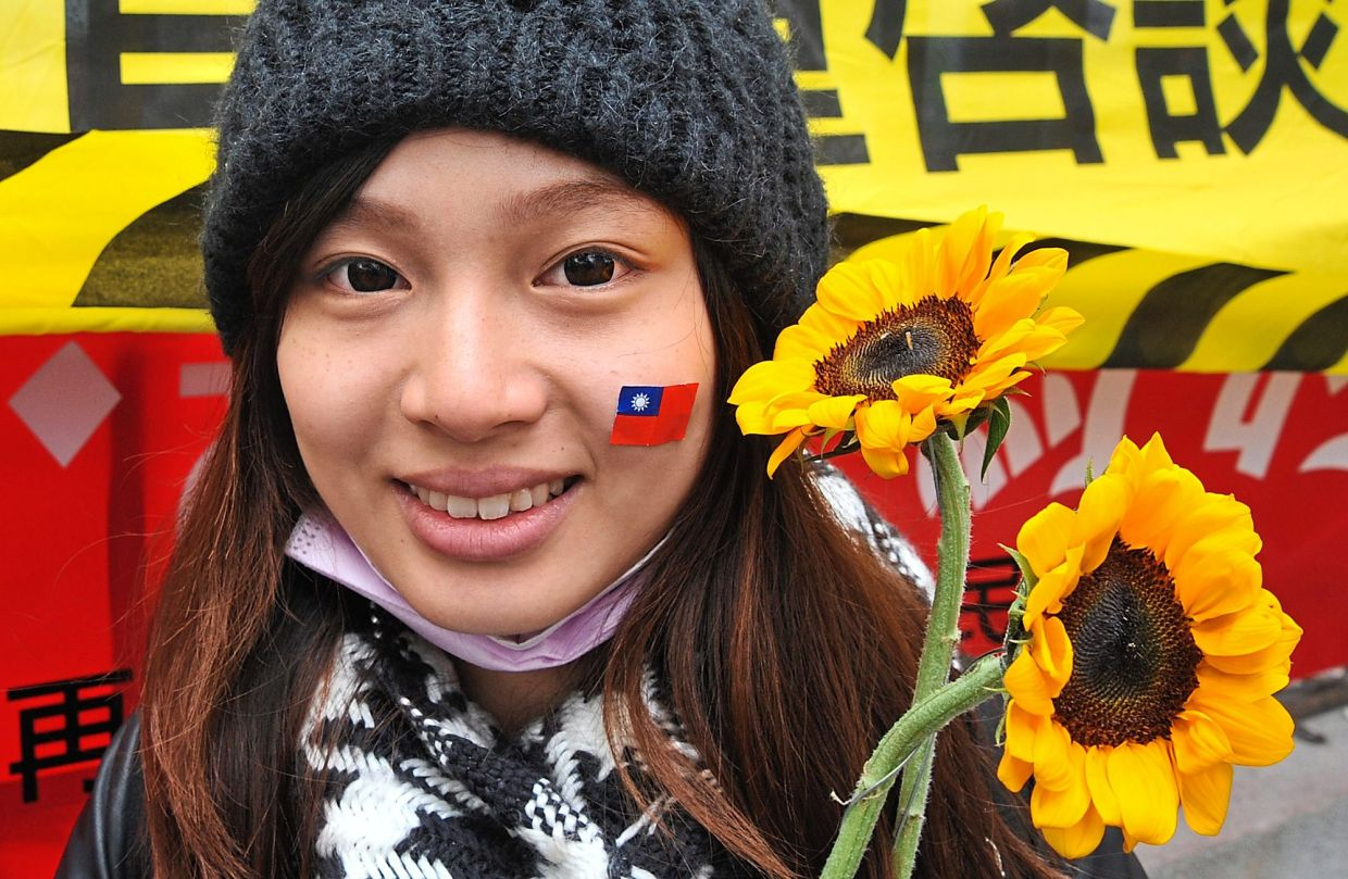 The Sunflower Student Movement, which occupied the parliament building in Taipei, Taiwan in 2014, led to the island adopting citizen input votes through mobile phone tech. — TNS
