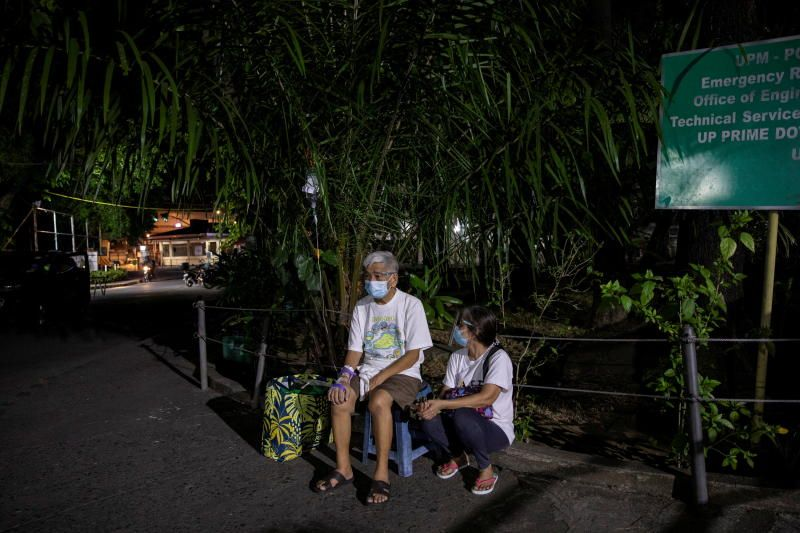 A patient at Philippine General Hospital is evacuated after a fire broke past midnight in the government-run facility amid the Covid-19 outbreak in Manila, Philippines, on Sunday, May 16, 2021. - Reuters