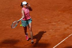 Tennis-Swiatek wins twice in a day to set up Rome final with Pliskova