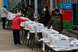 Chileans head to polls to pick architects of new constitution