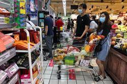 Taiwan urges no panic buying as new COVID-19 rules kick off