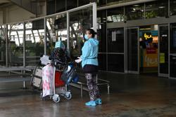 Australia sticks by plan to re-open border in mid-2022