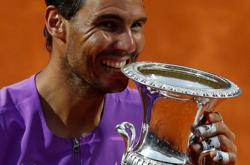 Tennis-Nadal overcomes blip to scythe down Djokovic in Rome final
