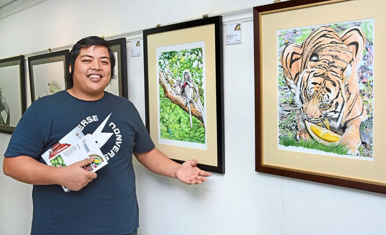 A filepic of Nasir showing his wildlife paintings at a joint exhibition back in 2018.