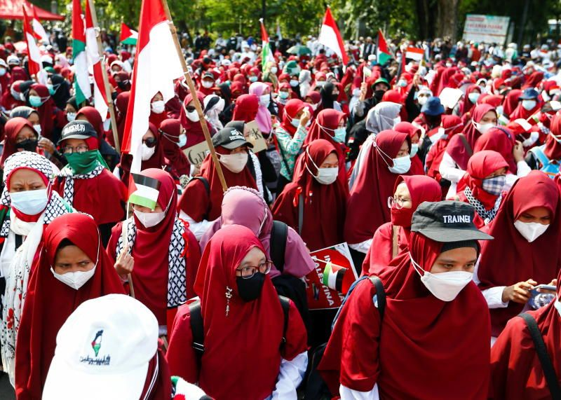 Activists stand during a protest against Israel outside the US Embassy in Jakarta, Indonesia, on Tuesday, May 18, 2021. - Reuters