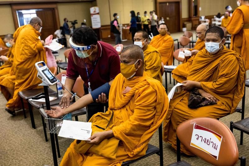 A Buddhist monk has his blood pressure checked during a Covid-19 coronavirus vaccine drive at the Priest Hospital in Bangkok on May 18, 2021. - AFP