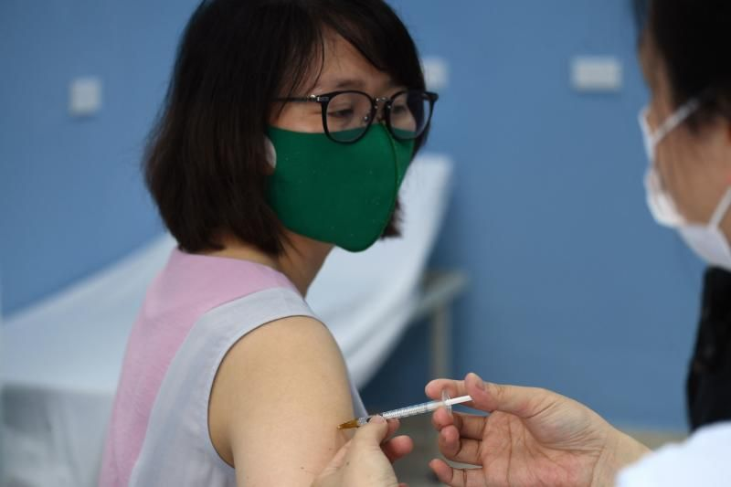 A health worker administers a dose of the AstraZeneca vaccine for the Covid-19 coronavirus at the Bach Mai Hospital in Hanoi. - AFP