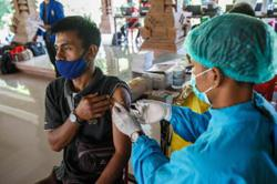 Indonesia rolls out company-funded vaccinations of workers