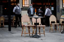 COVID-weary French cafes, stores impatient for new lockdown easing