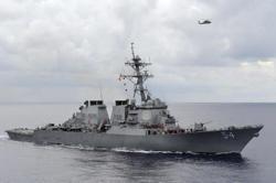 China says US threatening peace as warship transits Taiwan Strait