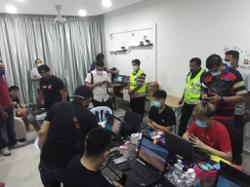 KL cops bust online gambling centre, nab eight
