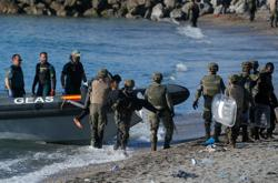 Migrants push for Spain's Ceuta again after border security tightened