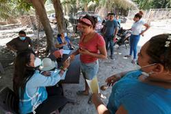 Partisan politics in Honduras fuels exodus, migrants say