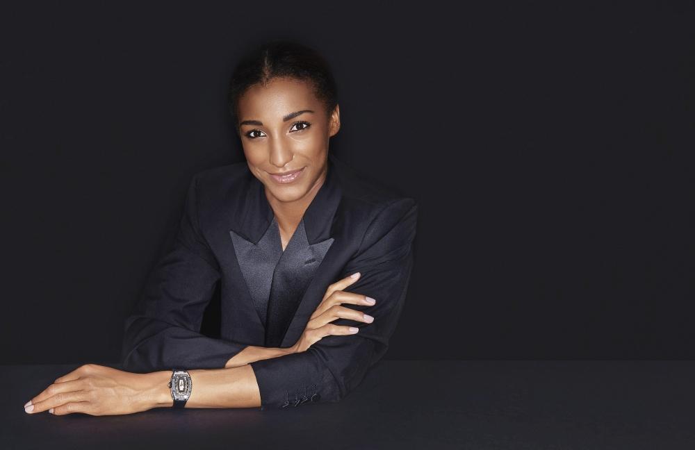 Brand partner, Belgian athlete Nafi Thiam wearing the RM 07-01 Automatic Ladies Carbon TPT baguette set diamonds.